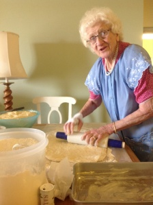 Grandma making cinnamon rolls